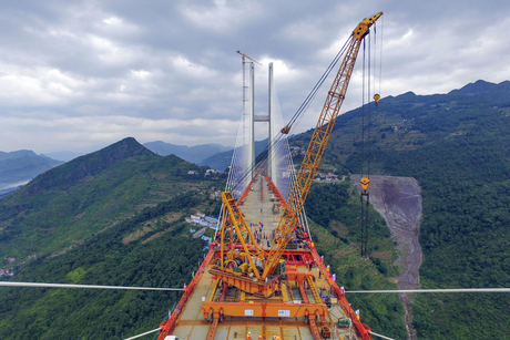 Workers connect world's highest bridge in China