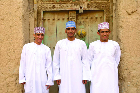 How can construction firms appeal to young Omanis?