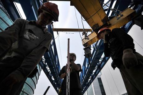 Worker denies Qatar contractor fired North Koreans