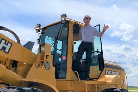 Video: Jeff Bezos rides John Deere loader for Amazon's Prime Air Hub