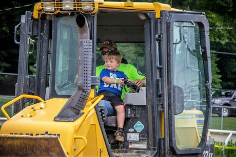US county fair invites children to operate construction machinery