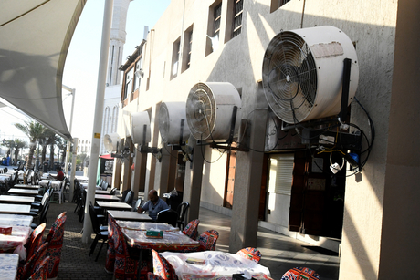 PICTURES: Sprinklers installed at key city spots to cool Kuwait