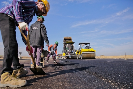 Oman's Ministry of Transport paves roads in the town of Al-Khubayb