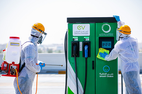 DEWA collaborates with ENOC, ADNOC to disinfect EV chargers
