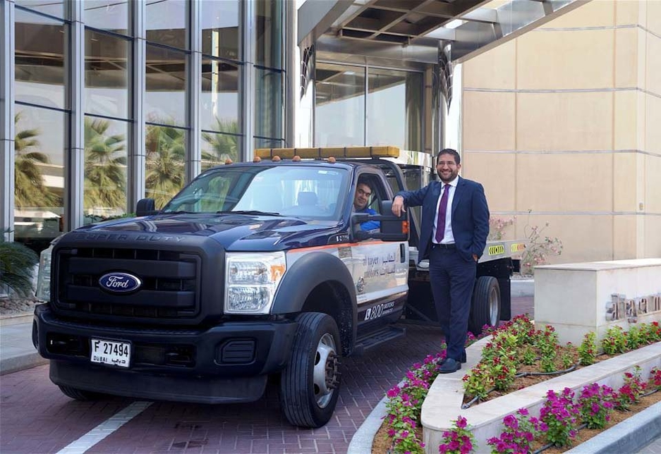 Bassam Shadid, transportation manager at Al Tayer Motors, stands alongside the milestone vehicle, driven by an Al Tayer staff member.