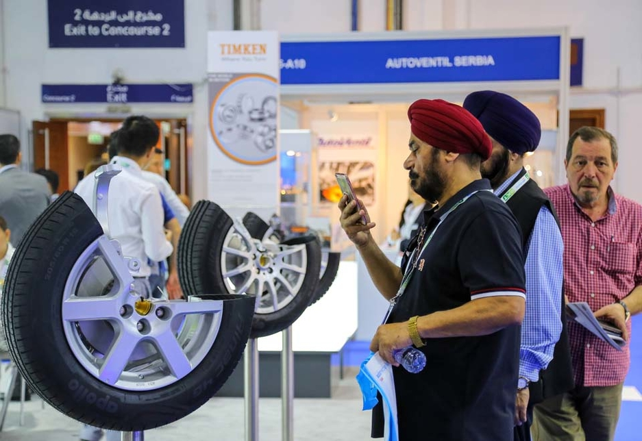 Visitors to Automechanika Dubai 2017 inspect the products on display at the show.