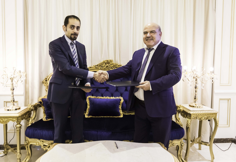 Mirwais Azizi (right) signed the 10-tower deal with Evershine Contracting.