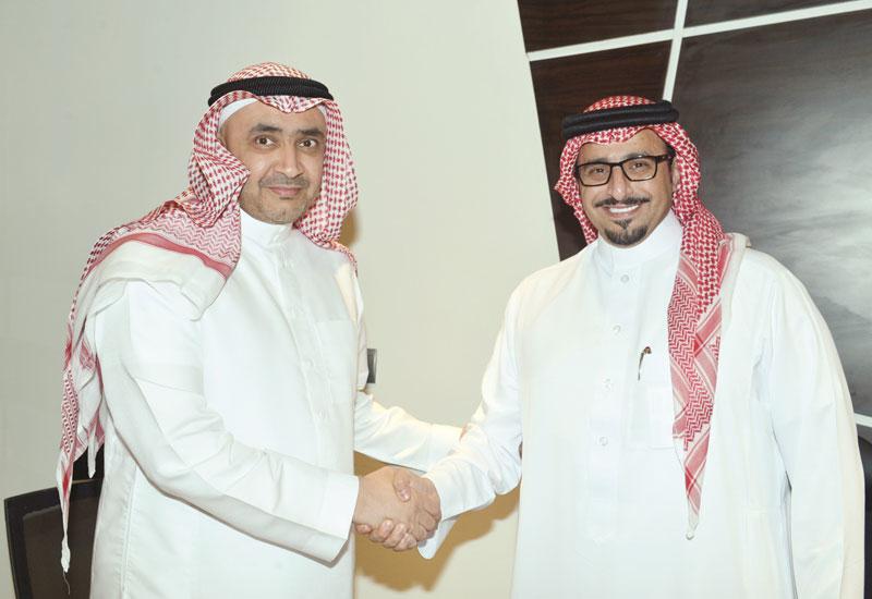 The contract was signed by Ruwad Civil Construction's Sheikh Salah Bin Hamdan Al Belawi (left) and Jabal Omar Development's Yasser Bin Faisal Al-Sharif (right).
