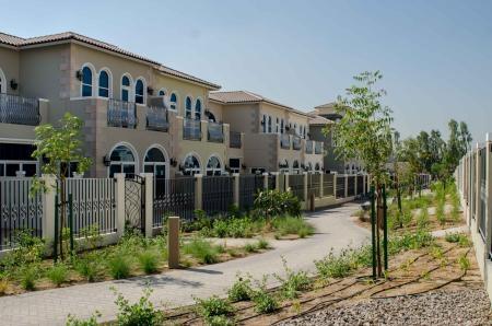 Casa Familia villas in Motor City Green Community.