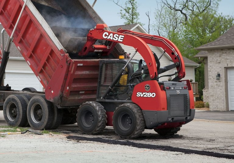 A limited edition SV280 skidsteer loader with red livery and anniversary insignia.