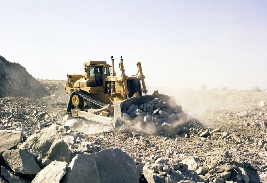 A Cat D10 TTT bulldozer model in 1980 delivers productivity in a hard rock application with the new elevated sprocket undercarriage and track design.
