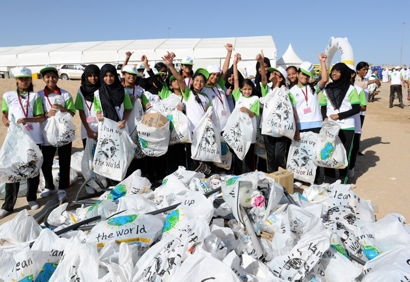Children participate in Clean Up The World campaign.