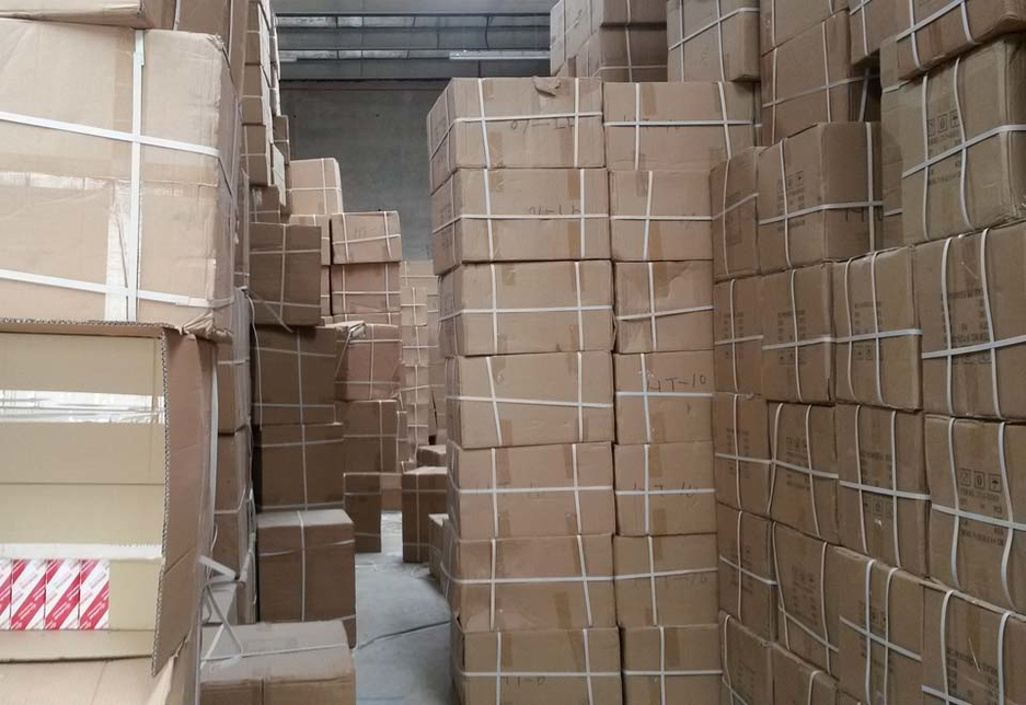 Stacked boxes of counterfeit parts seized by Al Ain Economic Development Department.
