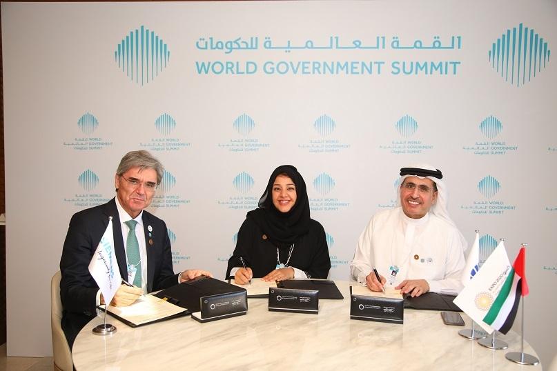 L tp R: Joe Kaeser, Siemens, HE Reem Al Hashimy, Dubai Expo 2020 Bureau, and HE Saeed Mohammed Al Tayer, DEWA.