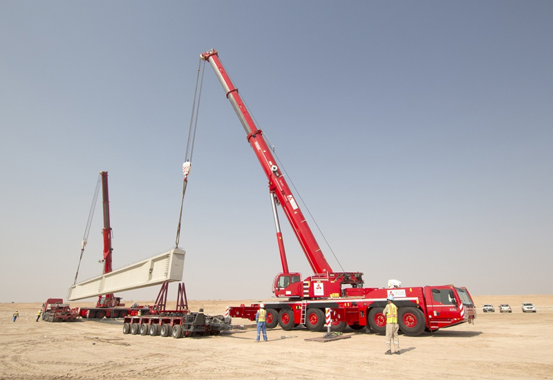 Two Demag cranes were used to lift concrete beams for Kuwait's Sheikh Jabar Causeway project [image: PMV Middle East].