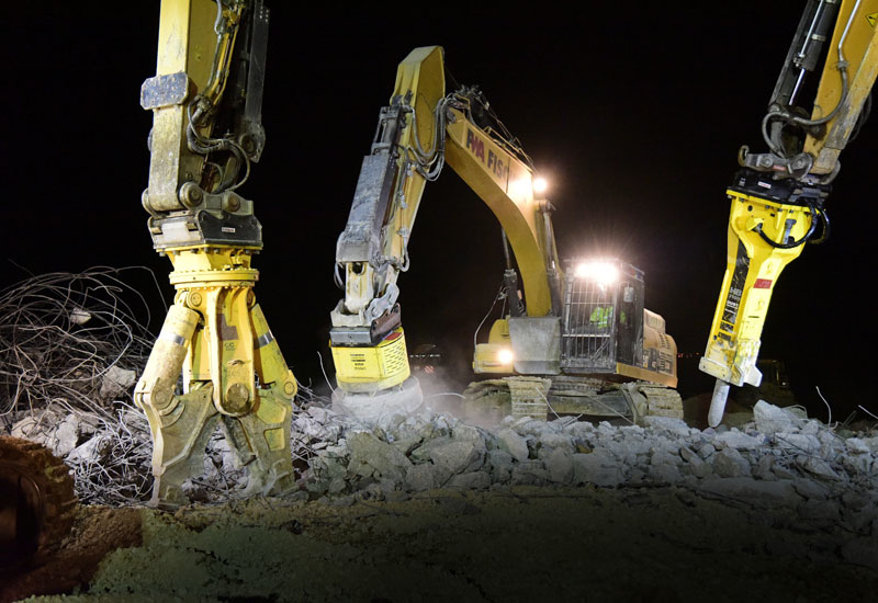 Demolition-grade machinery from Atlas Copco works overnight.