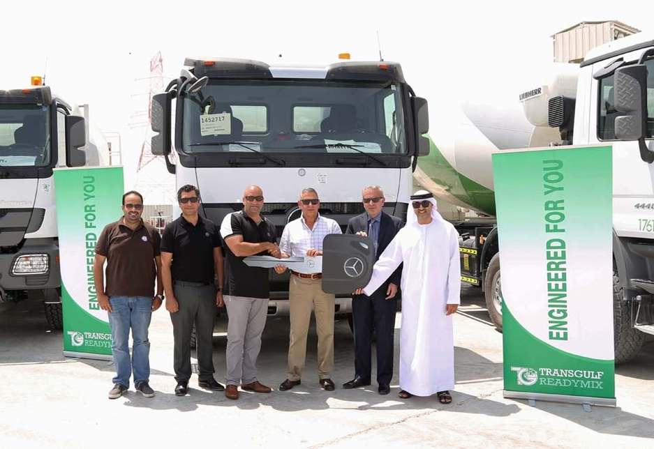 Representatives from Emirates Motor Company and Transgulf Readymix attend the handover of the trucks.