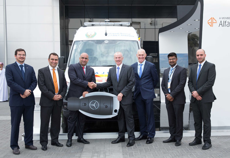 The EMC and National Ambulance Company team at the official handover at The Arab Health Expo in Abu Dhabi.
