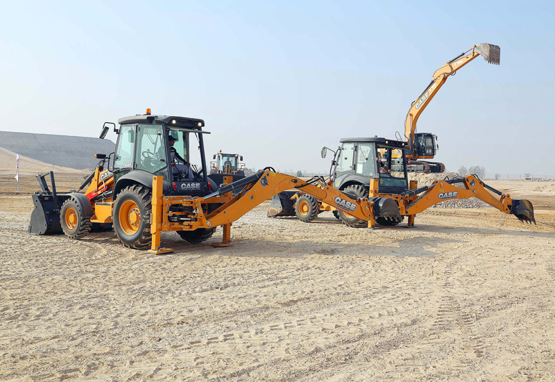 Case's 570T backhoe loader, with its rugged design for developing markets, as well as the newer 580T were both present — the backhoe on the left with an extend-a-hoe.