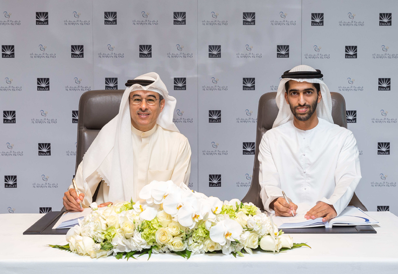 The agreement was signed by Sheikh Khalid Bin Saud Al Qasimi, chairman of Al Marjan Island (right), and Mohamed Alabbar, chairman of Emaar Properties (left).