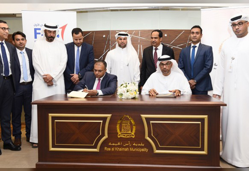 First Abu Dhabi Bank and RERA-RAK have signed an escrow agreement [image: WAM].