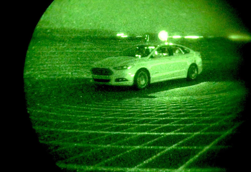 Night vision reveals the LiDAR ladar pulses to the human eye in the form of a grid of infrared beams projected around the vehicle.
