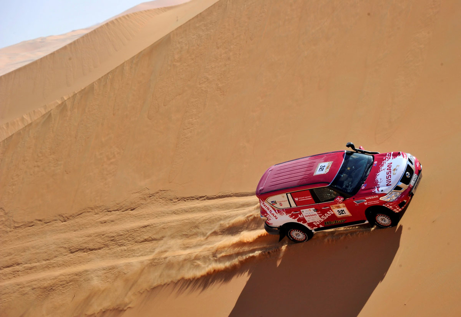 A rally car navigates a Liwa dune during the Abu Dhabu Desert Challenge 2015.