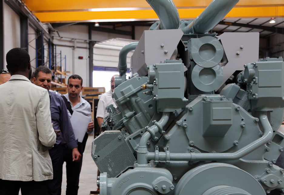 Visitors from the Algerian Ministry of the Environment inspect the installed standby generator set with the commissioning contractor SICE.