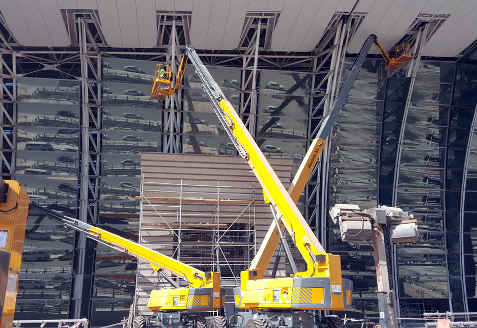 Haulotte H43TPX rough-terrain telescopic boom lifts support façade work on the King Abdulaziz International Airport terminals as part of the ongoing expansion work.