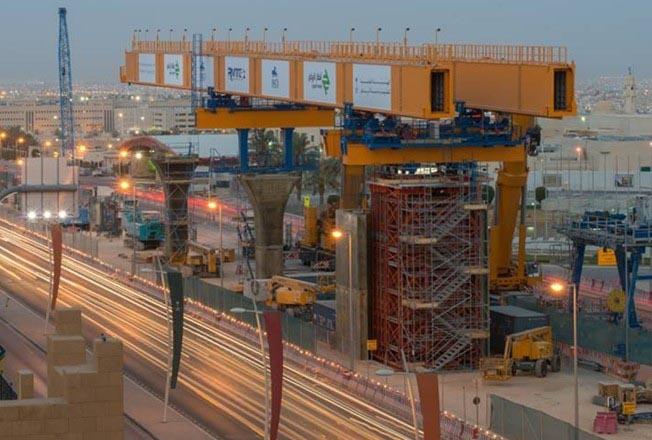 Haulotte machines support a gantry-type erection machine at work on the Riyadh Metro.