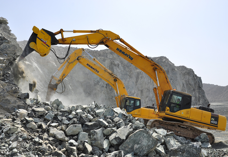 Two Komatsu Pc400s lay into a rock face with Xcentric rippers hydraulic breaker attachments.