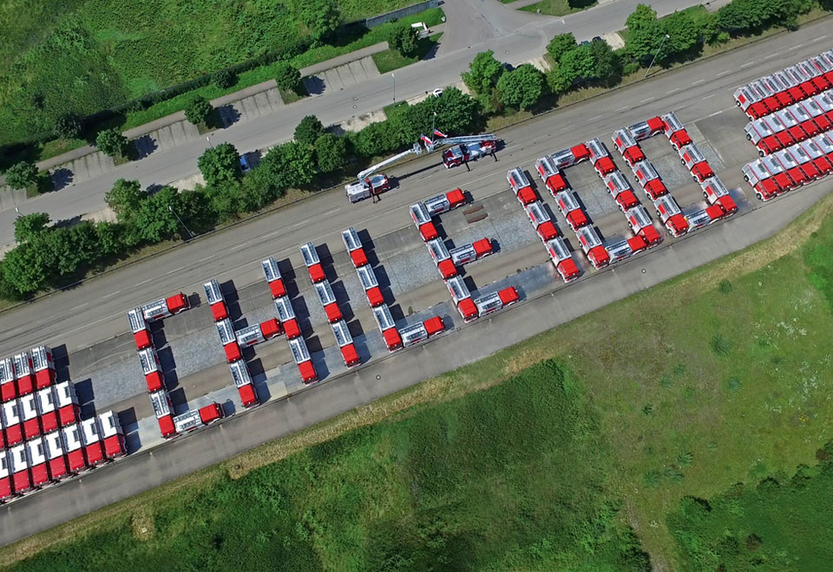 The order of 100 Magirus fire engines arrange to spell out 'Chile 100' in Germany.