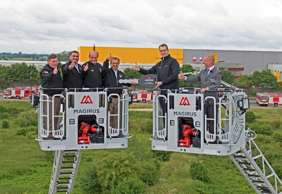 The handover was conducted 30m above ground by Magirus CEO Marc Diening on two Magirus M42L-AS articulated turntable ladders in Germany.