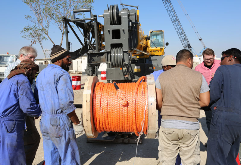 Manitowoc, Samson and CCC employees prepare to install the K-100 on the Grove.