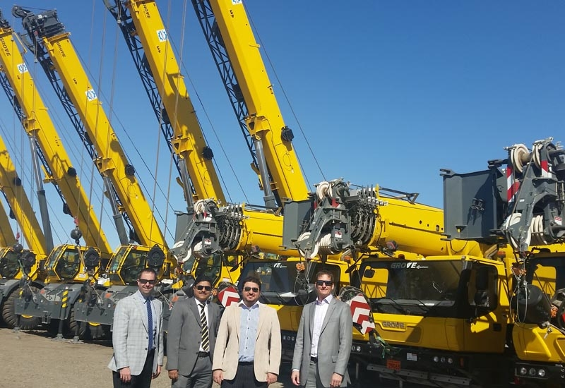 Staff from Manitowoc and Equipment Co celebrating the sale of 13 Grove cranes to Arabi Enertech.