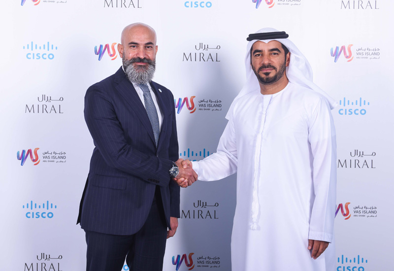 Shukri Eid, Managing Director  East Region, Cisco Middle East shakes hands with Mohamed Abdalla Al Zaabi, CEO of Miral after signing the MoU.