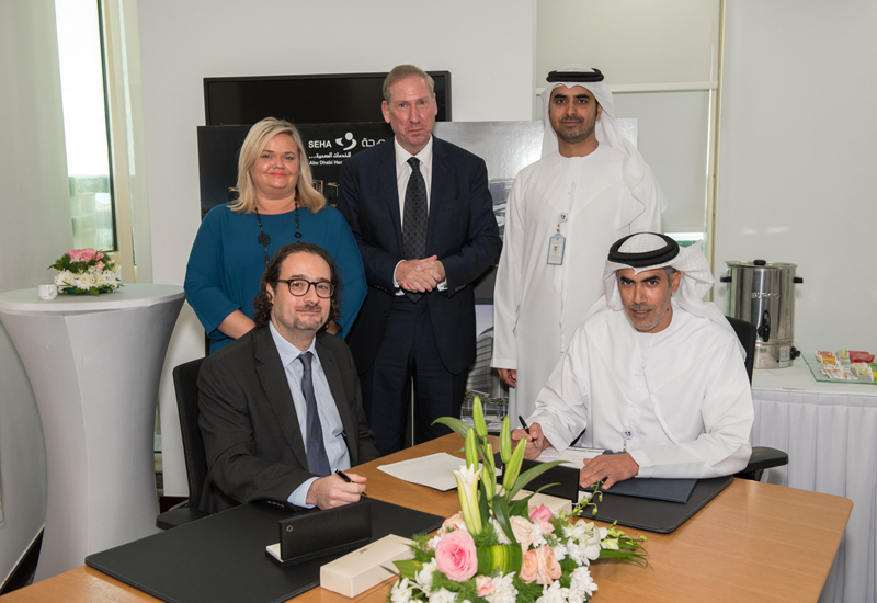 Standing from left to right: Fiona McDonnell (OCS general manager) Martin Logue (OCS Middle East managing director) Engr. Mohammed Hassan Al Zaabi (SEHA Group chief operations officer). Sitting from left to right: Ziad Al Askari (COO & chairman) and Mohammed Hareb Al Qemsi (group chief support services officer).