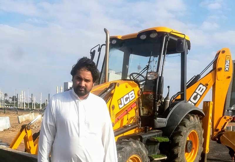 Omer Mukhtar with the recovered JCB 3CX backhoe loader.