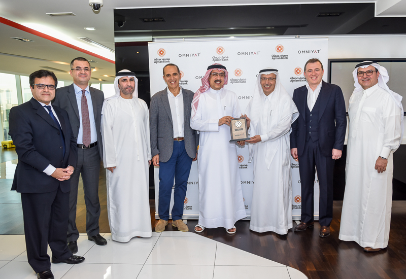 Officials from Omniyat, Ajman Bank, and other project stakeholders.