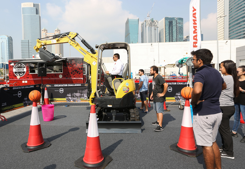 Bahrain-based Al Mahroos is challenging attendees to score a series of slam dunks in as short a time as part of its PMV Live excavator challenge.