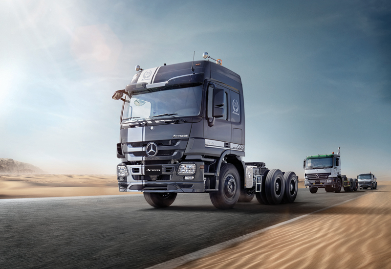 The 20th MENA anniversary Mercedes-Benz 3844 S 6x4 truck with its striking carbon black livery with silver stripes, chrome finish air-horns and a '20 Years Actros' emblem.