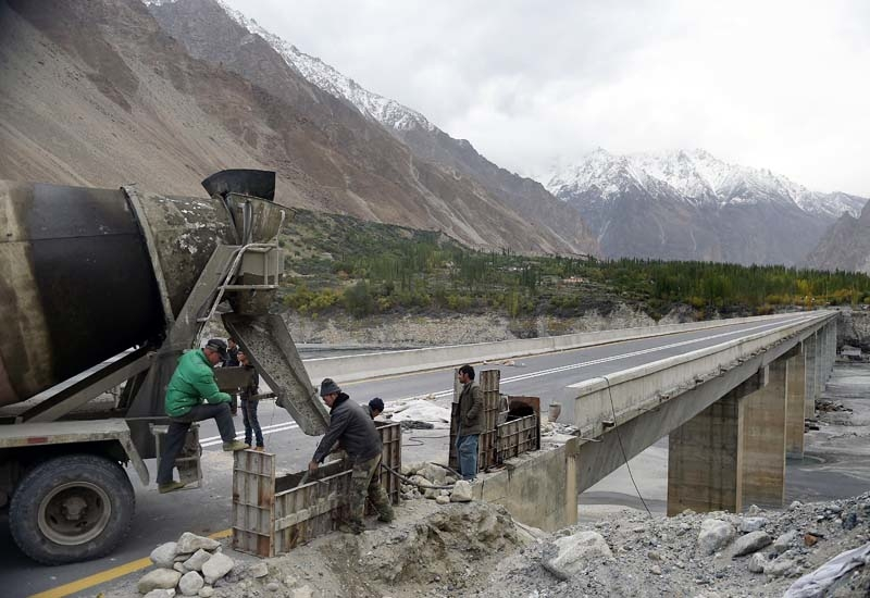 Chinese labourers work to shore up a stretch of the Karakoram highway in the Hunza valley in northern Pakistan.