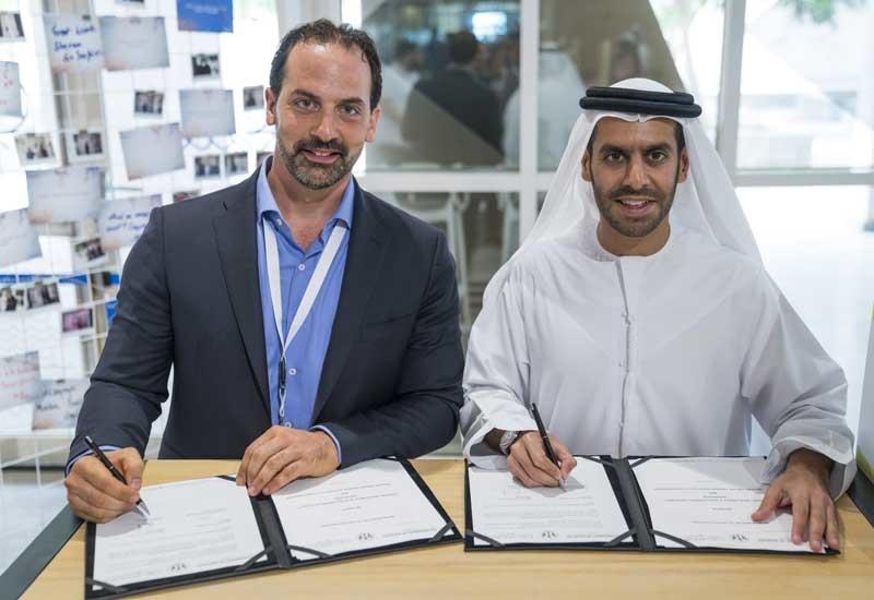 L-R: ProTenders' Karim Helal with Shurooq's Marwan Al Sarkal.