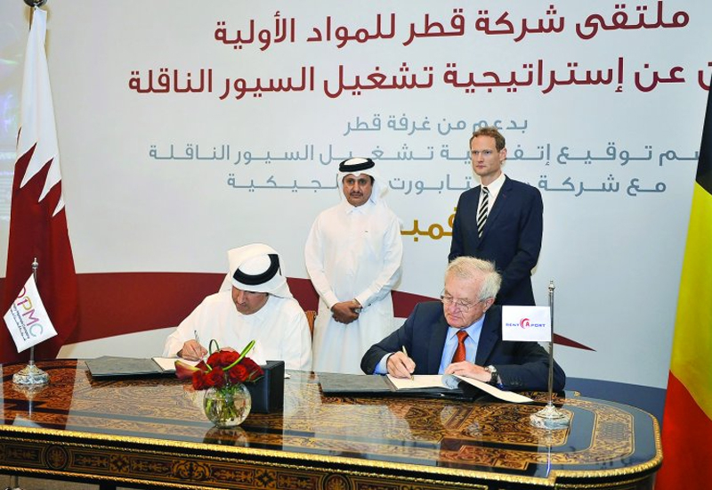 Eisa Al Hammadi, (left) QPMC Chief Executive Officer, and Marcel Van Bouwel, General Manager of Rent-A-Port, signing the contract in the presence of Sheikh Khalifa bin Jassim Al Thani and Christophe Payot, Ambassador of Belgium, in Doha yesterday. (Pic:Baher Amin / The Peninsula.)