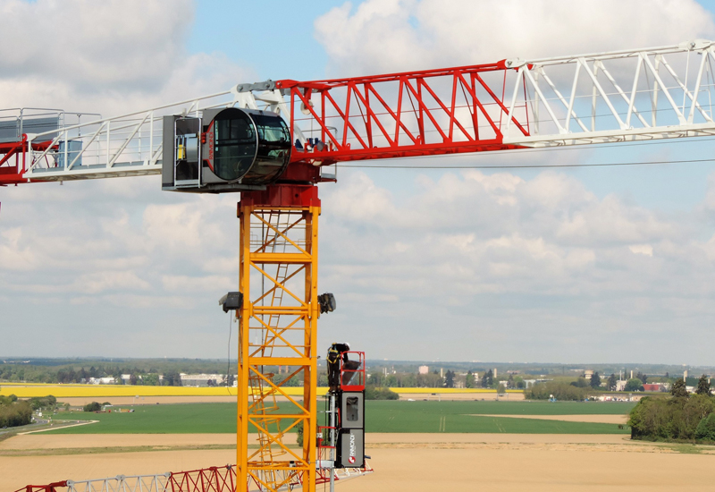 A Raimondi MRT294 tower crane fitted with the Deluxe R16 cabin and elevator.