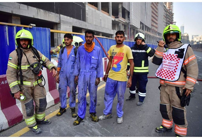 DCD and Dubai Police rescued three construction workers who were trapped in the fire-stricken building [Image: Dubai Civil Defence].