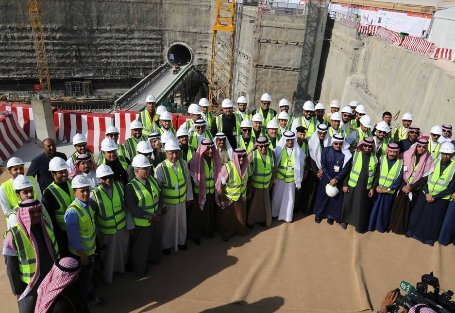 Workers pose with Riyadh's governor at the construction site for the Downtown Station.