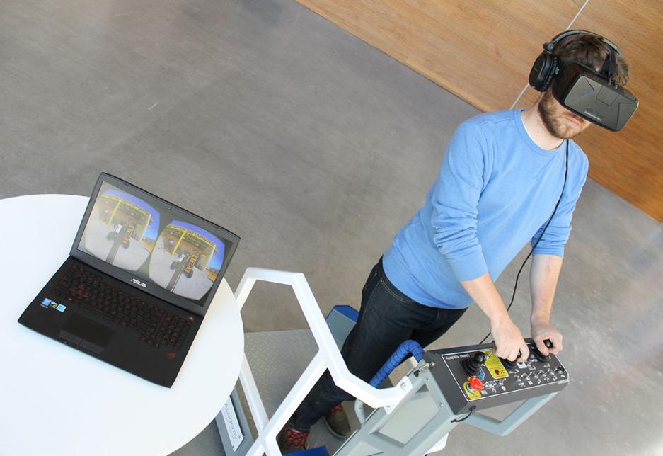 A developer at Serious tests an aerial work platform VR training simulation.