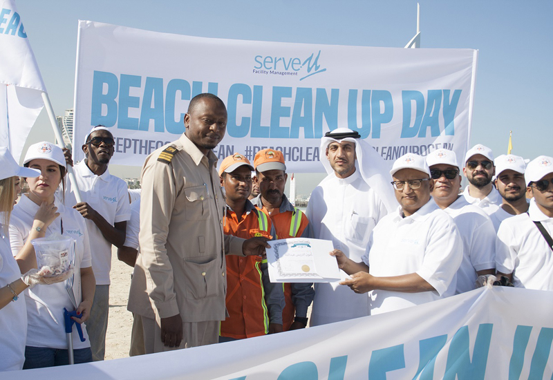 Around 60 employees took part in the beach clean-up drive