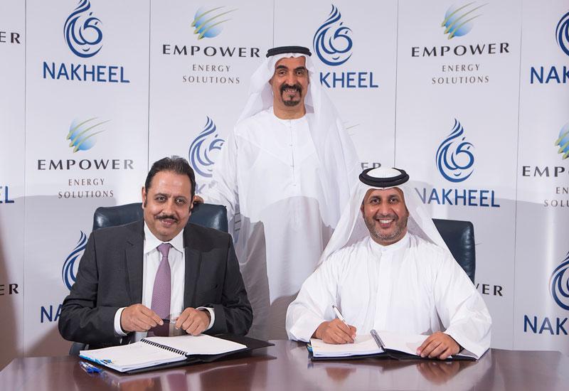 Ahmad Bin Shafar, CEO of Empower and Sanjay Manchanda, CEO of Nakheel sign the deal.
